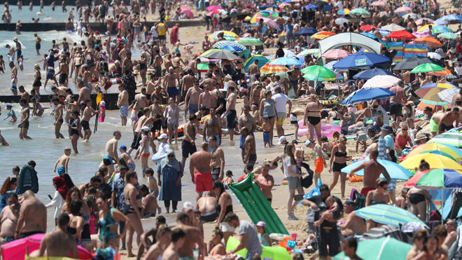 Sun-seekers at Bournemouth beach today