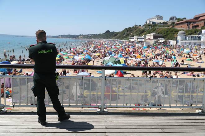 An ambulance crew member overlooking Bournemouth beach