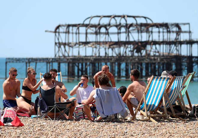Some beach-goers in Brighton appeared to dismiss social distancing measures