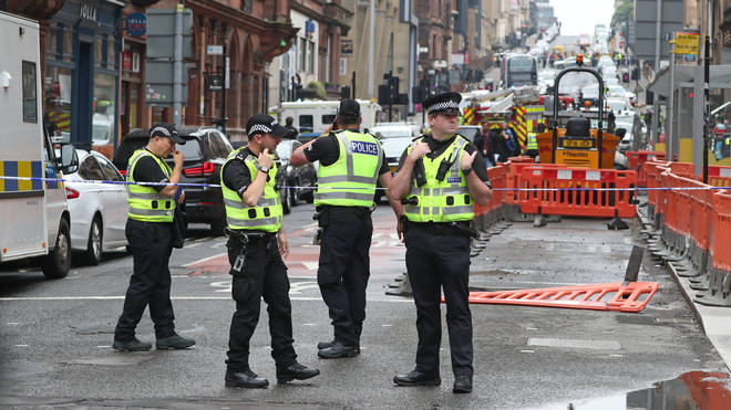 Police officers at the scene in West George Street, Glasgow