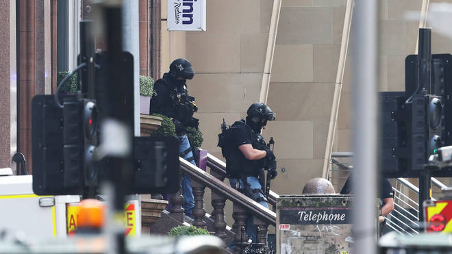 Armed police officers leave the Park Inn hotel in West George Street, Glasgow