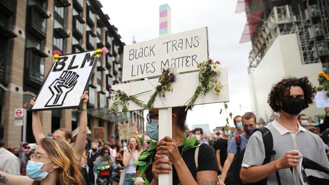 Demonstrators held signs reading 'Black Trans Lives Matter'