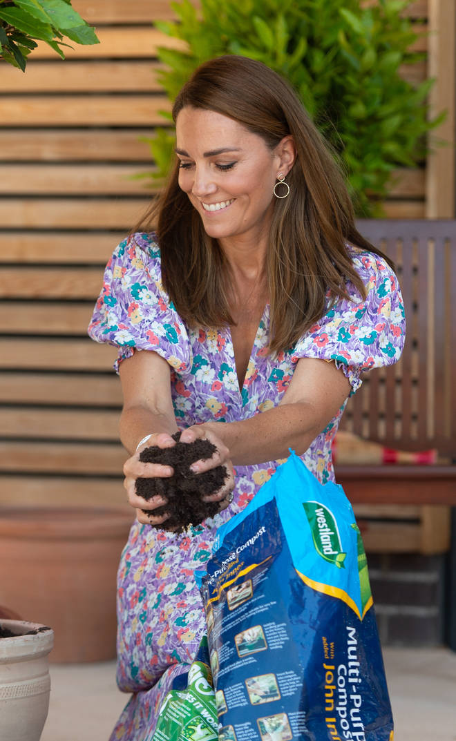 The Duchess of Cambridge helps to pot plants and herbs