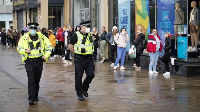 Police patrol in Edinburgh as shoppers queue