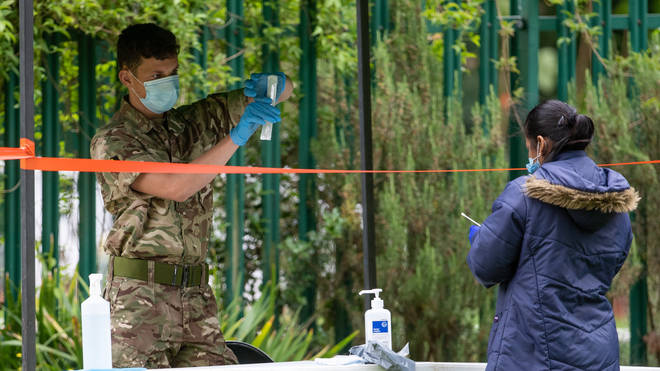 Members of the military operate a walk-in mobile Covid-19 testing centre at Spinney Hill Park in Leicester