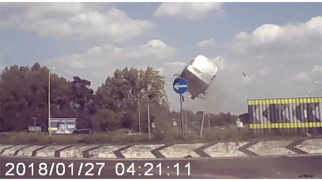 The speeding van hits the roundabout and flies through the air