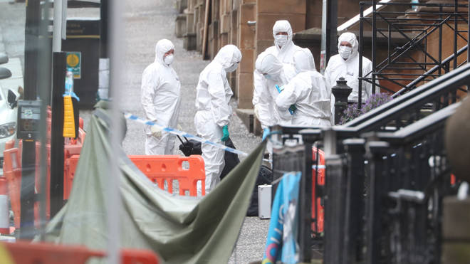 Forensic investigators at the scene in Glasgow