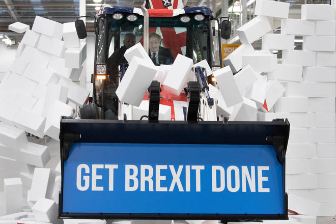 Boris Johnson bulldozing through a wall with the message 'Get Brexit Done'