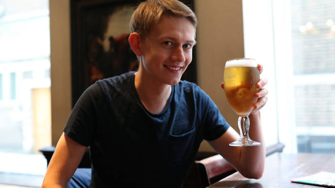Customer Peter Kutapan enjoys a drink at the Shakespeares Head pub in Holborn