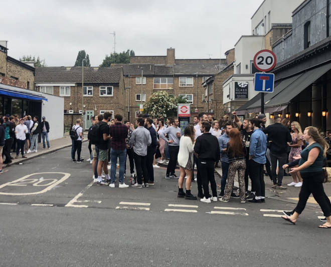 A large crowd outside a pub in London