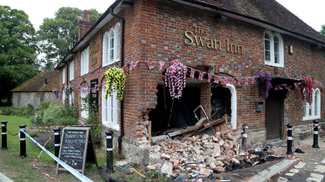 The crashed car left a gaping hole in the pub wall