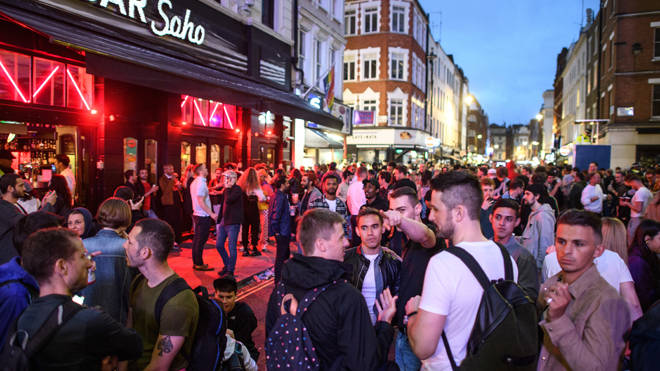 A large crowd in Soho in London last night