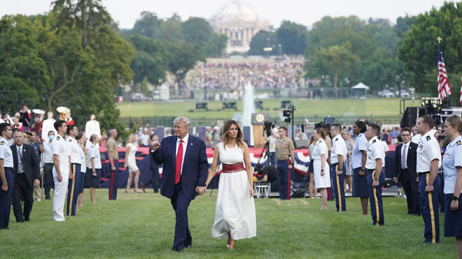 Donald Trump and Melania walk back to the White House after the 4th July speech