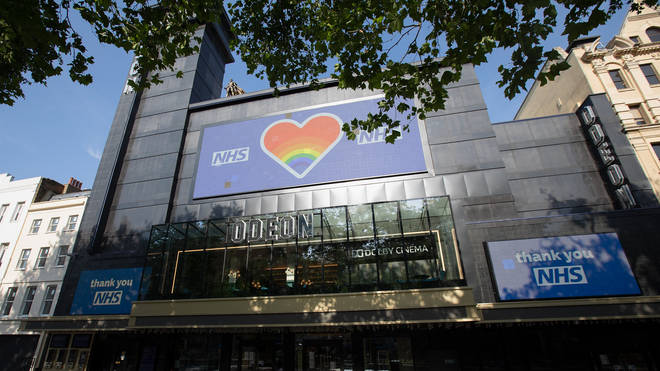 A view of the closed Odeon Luxe Cinema showing NHS Tribute Signs in Leicester Square during the Covid-19