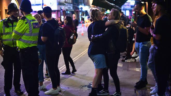 People enjoy a drink in Soho last night