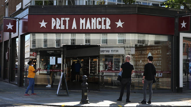 Customers wait outside a branch of Pret A Manger in London
