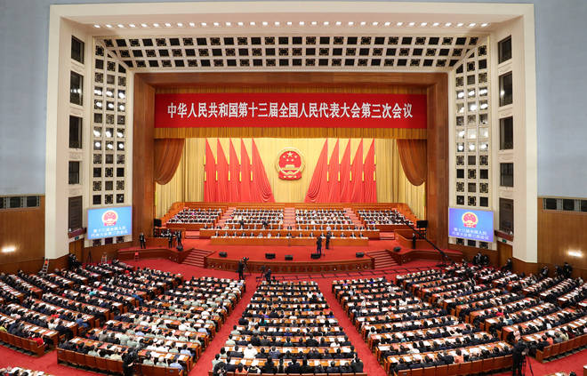 Chinese officials in the Great Hall Of The People in Beijing