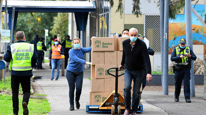People distribute supplies in the lockdown in Melbourne