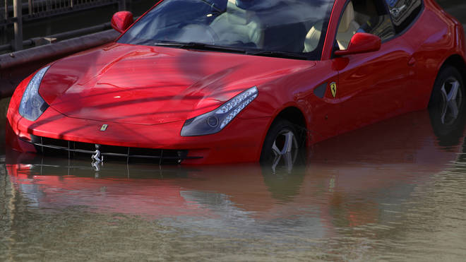 Cars remain abandoned on the A406 after the flooding