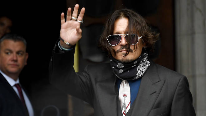 Johnny Depp waves outside the High Court in London