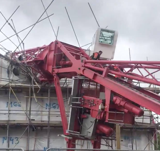 The crane crushed at least two houses as it collapsed