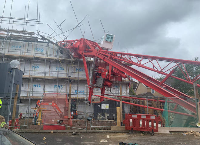 Pictures show how the crane tore through the buildings