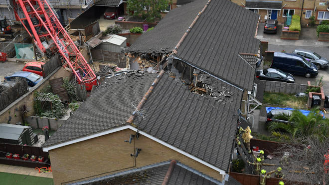 One woman died when the crane came down on houses