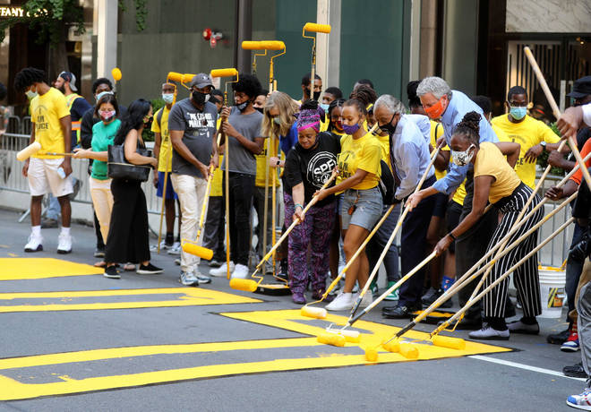 New York City Mayor Bill de Blasio, his wife Chirlane McCray, and the Rev. Al Sharpton all helped with the painting
