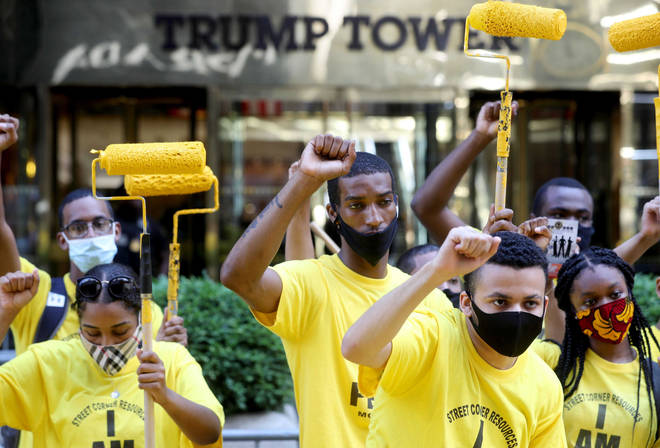 Activists stood outside Trump Tower in Manhattan