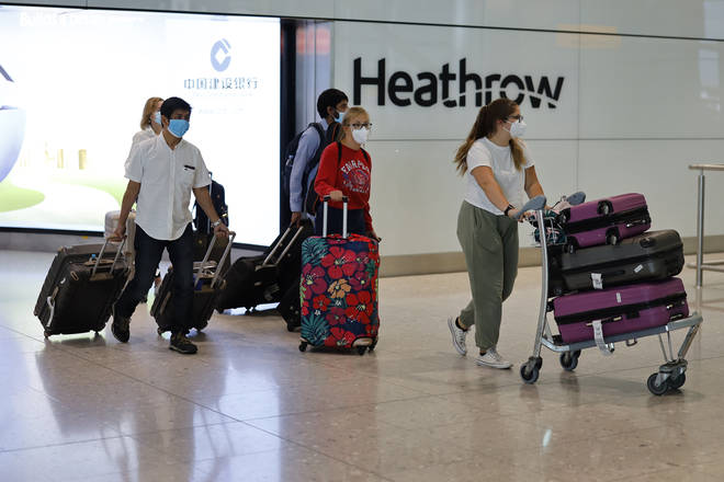 File photo: Passengers wearing PPE arrive at Terminal 2 of Heathrow airport