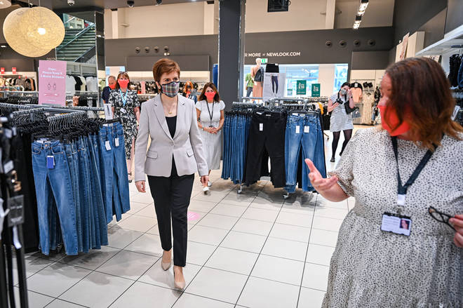 First Minister Nicola Sturgeon, wearing a Tartan face mask during a visit to New Look