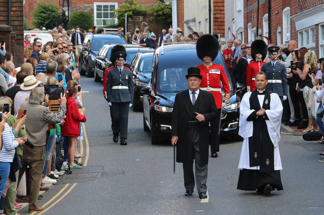 The funeral cortege of Forces Sweetheart Dame Vera Lynn is escorted through Ditchling
