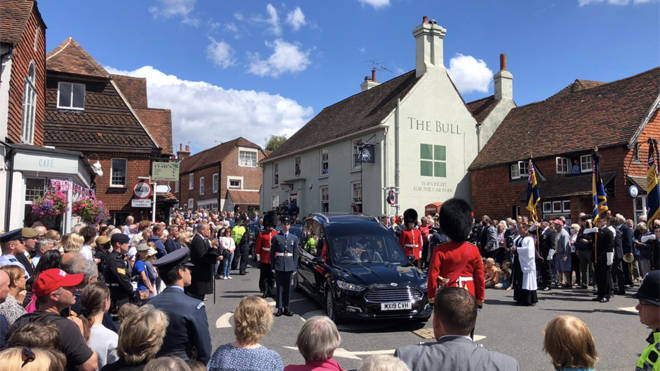 Dame Vera Lynn's funeral cortege passes through the village of Ditchling