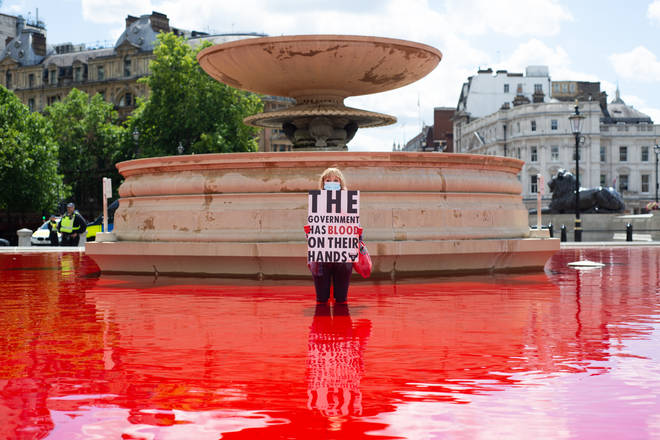 Activists dyed the Trafalgar Square fountains red on Saturday