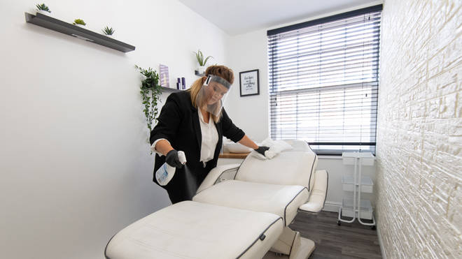 Clare Gleadell cleans and disinfects surfaces at Beautique beauty salon in Loughborough