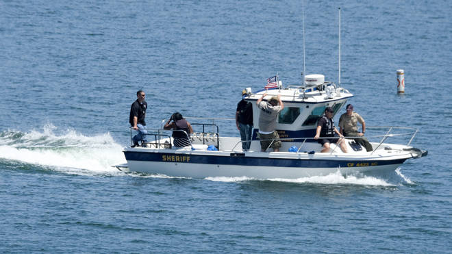 Naya Rivera's father, George Rivera, second from right, and mother Yolanda, second from left, with members of Ventura County Sheriff's Office, are seen in a boat after Naya Rivera's body was found in Lake Piru