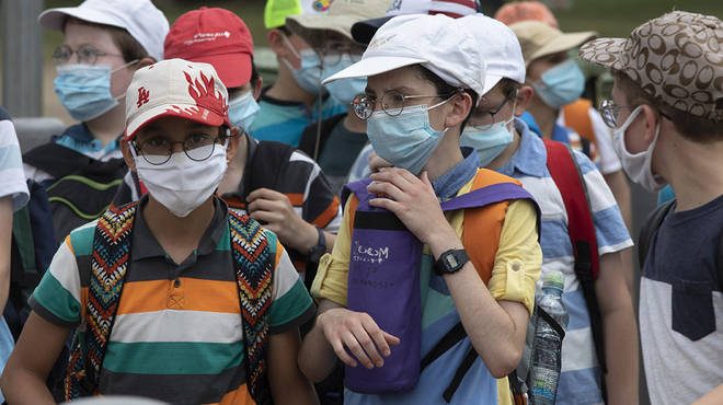 Children wear face masks to school in other countries following the coronavirus pandemic