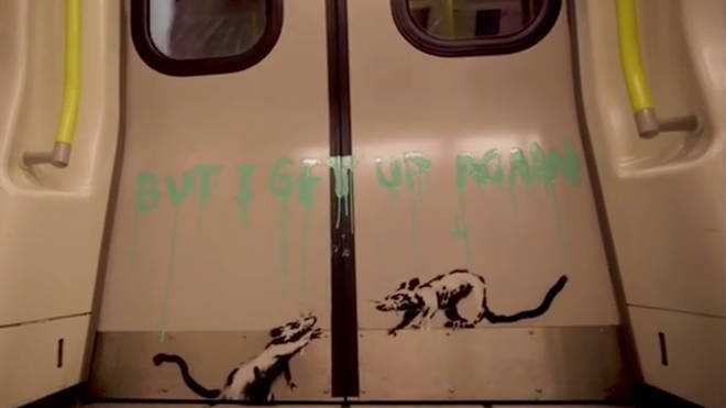 Banksy has been filmed spray painting the tube