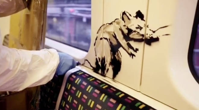 The artwork features Banksy's familiar rats