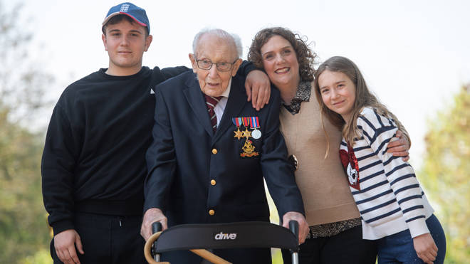 Captain Tom Moore, with (left to right) grandson Benji, daughter Hannah Ingram-Moore and granddaughter Georgia