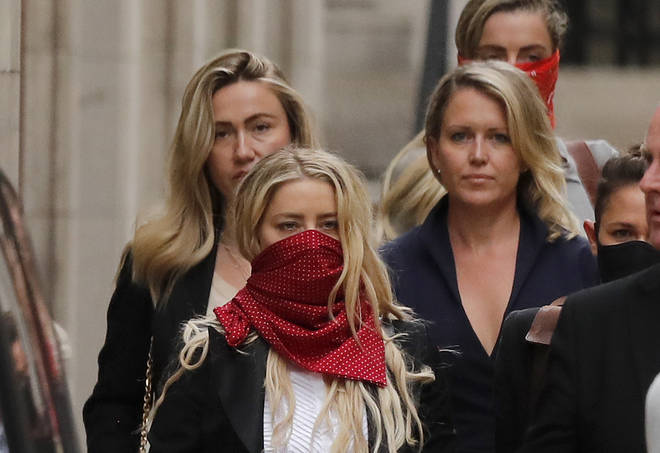 Amber Heard leaving the high court on Wednesday