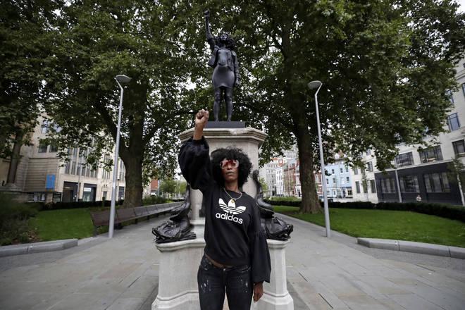 Jen Reid standing in front of the statue yesterday