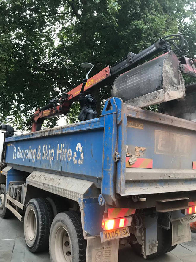 The statue was loaded into a skip lorry and taken away