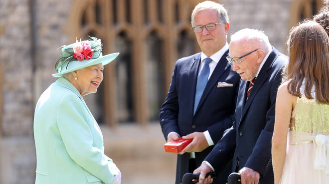 The Queen knighted Sir Tom in a unique open-air ceremony