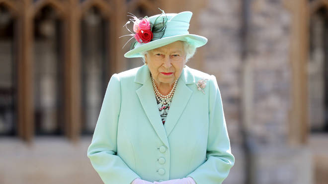The Queen chatted with Sir Tom about his achievements and the pandemic