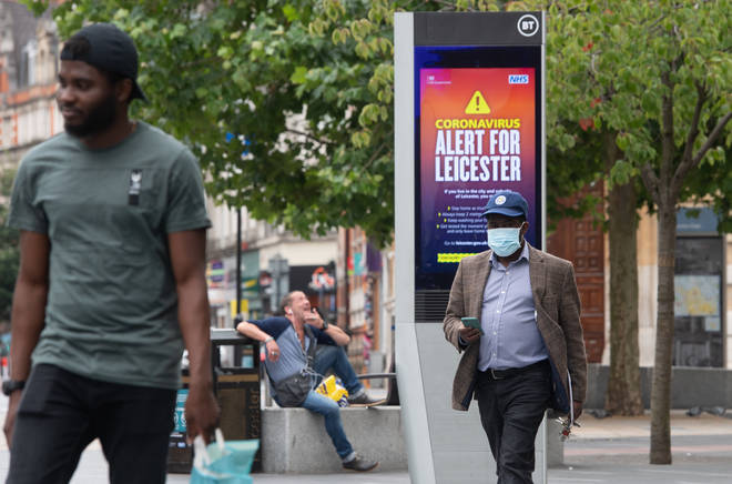 Coronavirus alert messages on a sign in the centre of Leicester, where localised lockdown restrictions have been in place since June 29