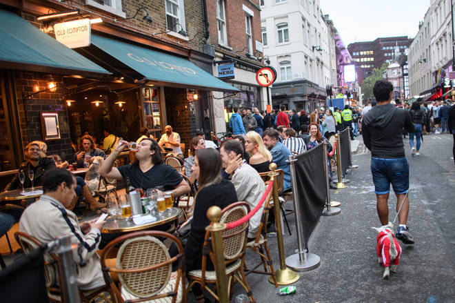 File photo: People eat and drink outdoors in Soho, London