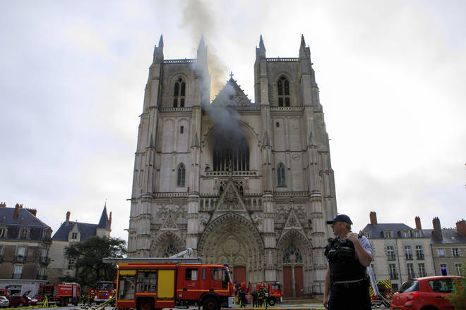 Fire fighters brigade work to extinguish the blaze at the Gothic St. Peter and St. Paul Cathedral, in Nantes