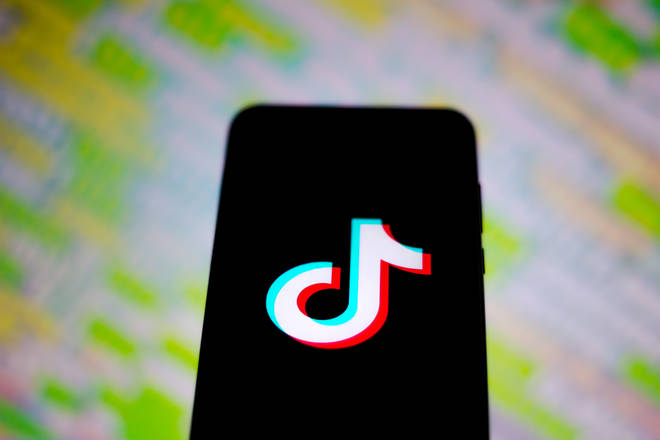 File photo: The TikTok logo displayed on a smartphone