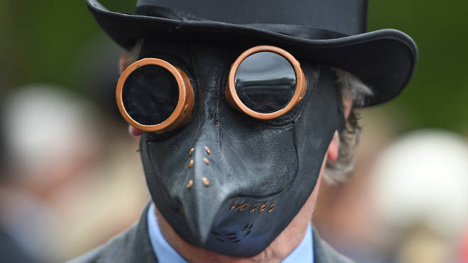 A man wearing a plague mask during the rally